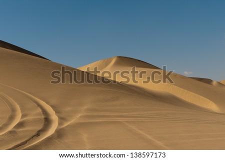 Wind-blown ripples in sand in the Qatari desert - stock photo