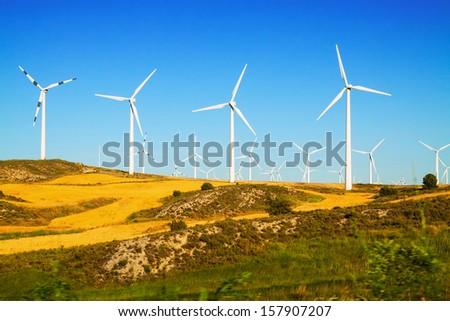 Wind farm at farmland. Aragon, Spain - stock photo