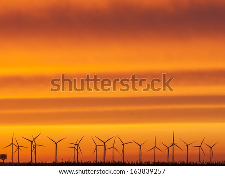 Wind farm in Scandinavia. Here in sunset in November. - stock photo
