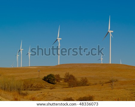 wind farm on a clear day - stock photo