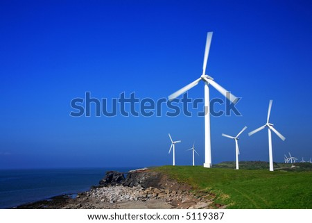 Wind farm with clear blue sky for copy space. More in my portfolio. - stock photo