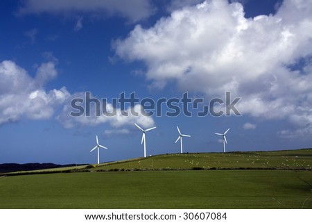 wind farm with large turbines moving in the breeze Isle of Anglesey - stock photo