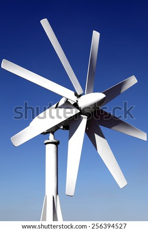 wind generator on the roof of the office. against the blue sky. Energy savings. Saving features electricity. - stock photo