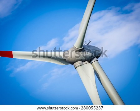 wind generator turbine in sky - close up - stock photo