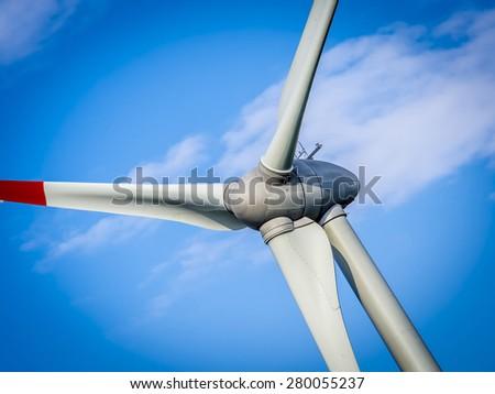 wind generator turbine in sky - close up - stock photo