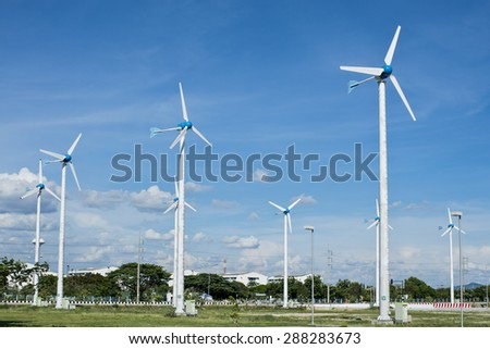 Wind Generators farm in industrial area - stock photo