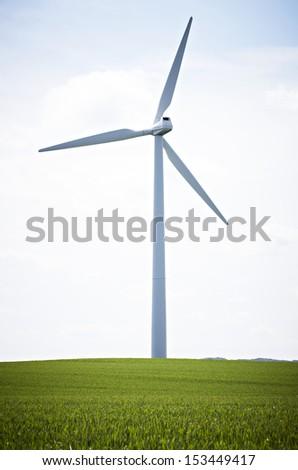 wind mill in green field - stock photo