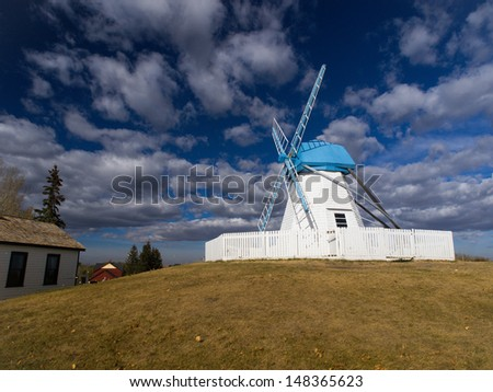 Wind Mill in Heritage Park. This museum / park is made of original buildings used in second half of 19th century which are then transported and on display in Heritage Park. - stock photo