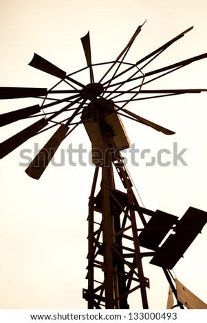 Wind mill in the Australian  desert - stock photo