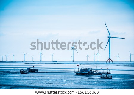 wind power farm in yancheng seashore,develop shoals concept - stock photo