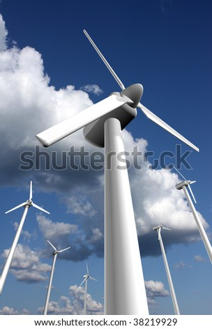 Wind power farm with sky and clouds in the background, dramatic perspective - stock photo