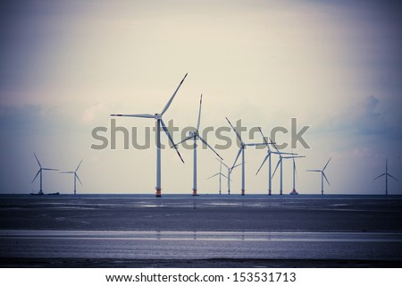 Wind power generation on the beach - stock photo