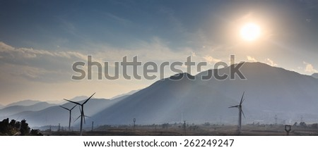 Wind power generator under backlight - stock photo