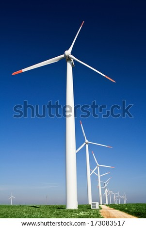Wind power generators with blue clear sky - stock photo