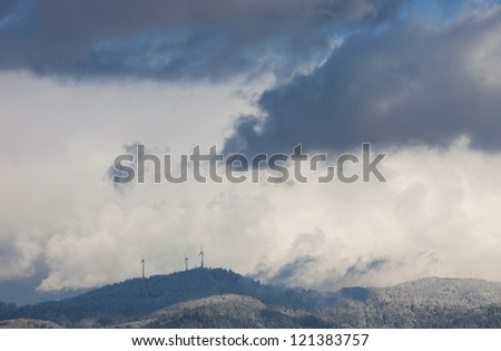 wind power mills in black forest in winter - stock photo