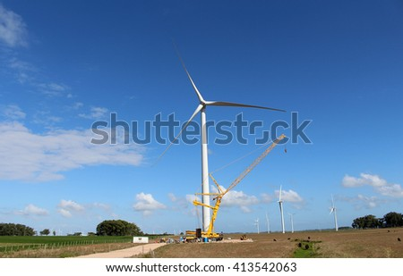 Wind Power Pinwheel Maintenance - stock photo