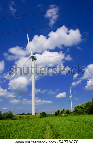 Wind power plant in european countryside. - stock photo
