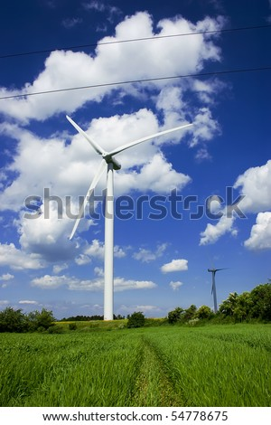 Wind power plant in european countryside. Second propeller hidden in shadow. - stock photo
