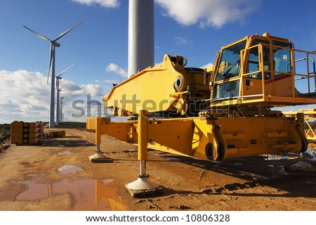 Wind power plant under construction. Mobile crane and wind turbine - stock photo