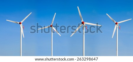 Wind power station against the blue sky. Wind turbines motion. - stock photo