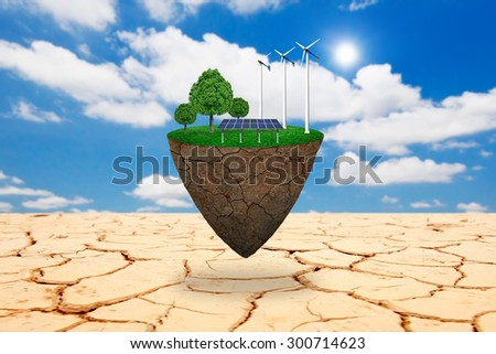 Wind power station mills and trees on the lawn. Natural concept. - stock photo