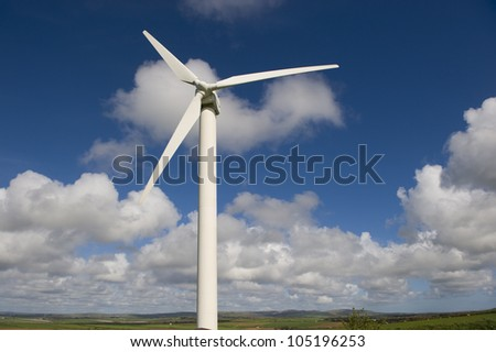 Wind turbine against the cloudy British sky. This is in Cornwall. - stock photo