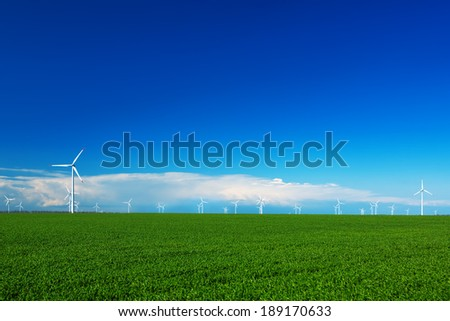 Wind turbine and green field - stock photo