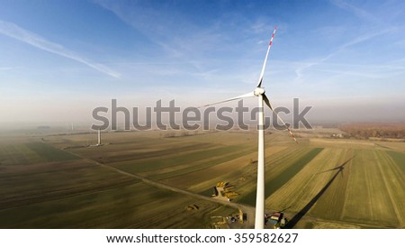 Wind turbine being under construction surrounded by agricultural fields in Polish country side. Poland, Western Part. Lubuskie voivodship. - stock photo