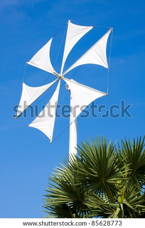 Wind turbine blade at blue sky - stock photo