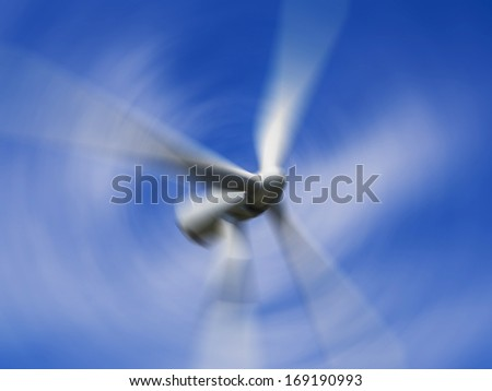 Wind turbine blades in motion - stock photo