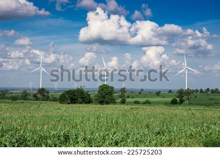Wind Turbine for alternative energy on background sky on Cassava plantation - stock photo