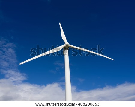 Wind turbine front view on blue sky - stock photo