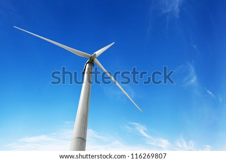 wind turbine generating electricity on blue sky - stock photo