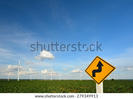 Wind Turbine in blue sky. - stock photo