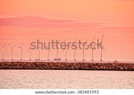 Wind turbine in Oresund at sunset near Copenhagen, Denmark - stock photo