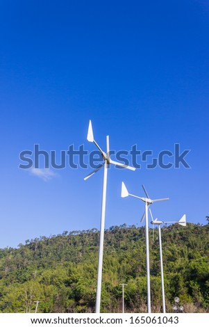 wind turbine mountain and sky - stock photo