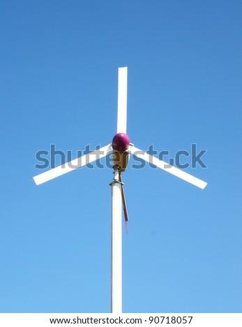 wind turbine on blue sky background - stock photo