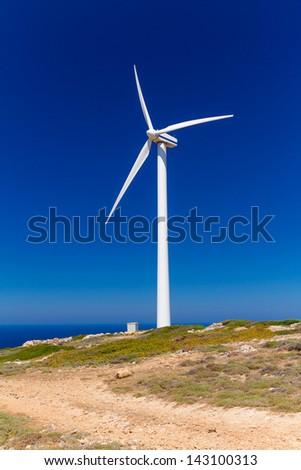 Wind turbine over blue sky on Crete, Greece - stock photo