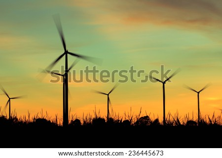 Wind turbine power generator at twilight sunset - stock photo