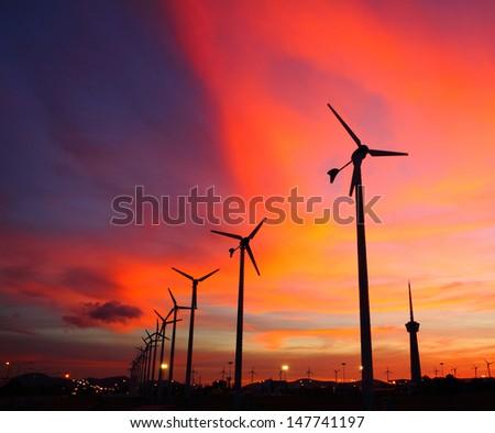 Wind turbine silhouettes at twilight, at Thailand  - stock photo