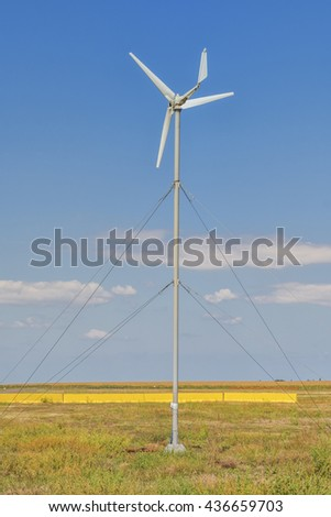 Wind turbine. Wind turbine is an alternative and green energy source. - stock photo