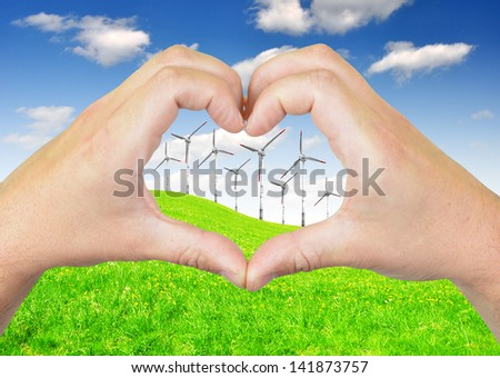 wind turbine with heart from hands - stock photo