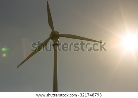 wind turbine with lens flares - stock photo