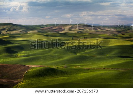 Wind Turbines. A electrical generating wind farm dots the horizon in the Palouse area of eastern Washington state seen from the famous Steptoe Butte landmark. - stock photo