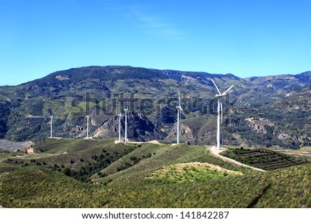 Wind turbines along the Sierra Nevada in Andalusia, Spain - stock photo