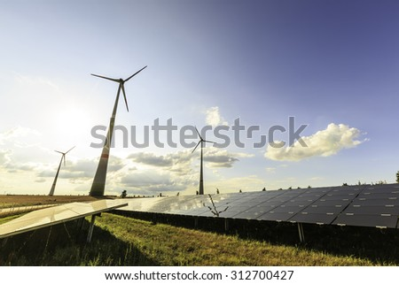 wind turbines and modern solar panels in the country side - stock photo