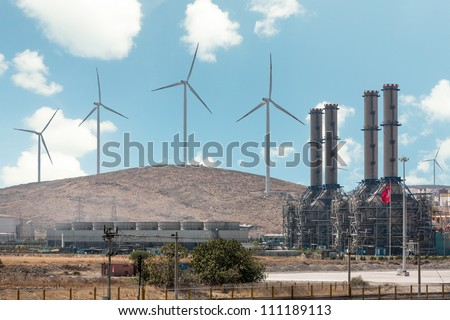 Wind turbines and the plant - stock photo