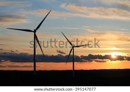 Wind Turbines at Sunset - stock photo