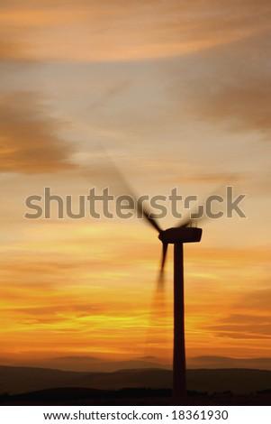 Wind turbines at sunset, Scotland - stock photo