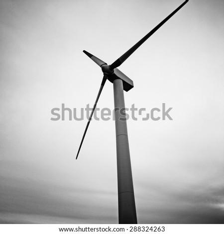 Wind turbines at the sunset. - stock photo